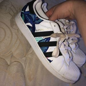 Superstar adidas with blue embroidery